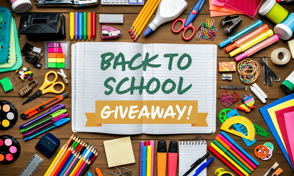 A variety of school supplies are laid out on a table surrounding a notebook that is open. Overlaying the notebook is text that reads Back to School Giveaway!