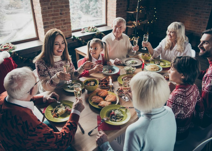 diverse family gathered around holiday dinner
